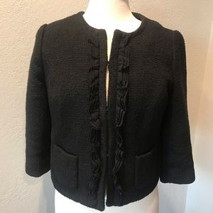 Black 3/4 sleeve blazer with ruffle details.